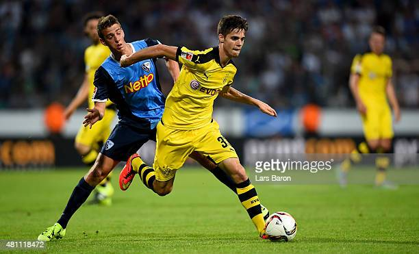 Janik Haberer of Bochum challenges Julian Weigl of Dortmund during a preseason friendly match between VfL Bochum and Borussia Dortmund at Rewirpower...