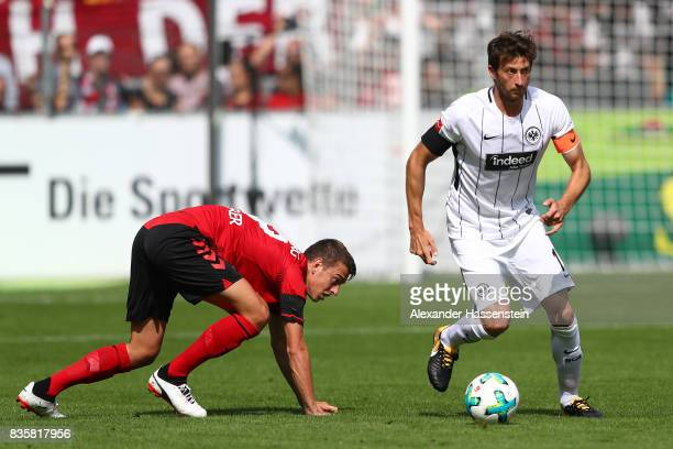 Janik Haberer of FC Freiburg and David Abraham of Frankfurt during the Bundesliga match between SportClub Freiburg and Eintracht Frankfurt at...