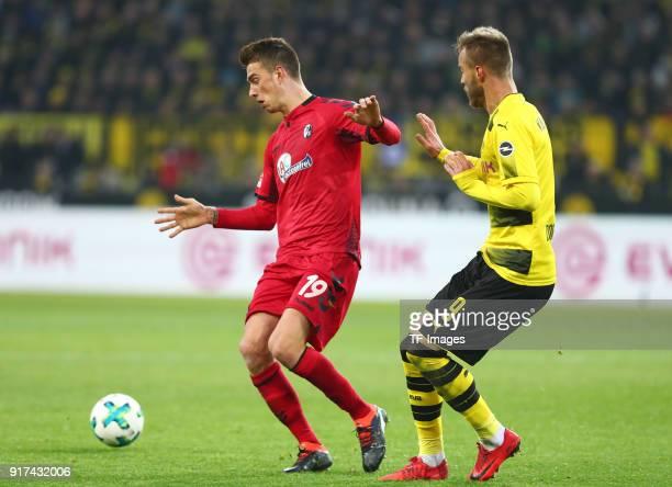 Janik Haberer of Freiburg and Andrey Yarmolenko of Dortmund battle for the ball during the Bundesliga match between Borussia Dortmund and SportClub...