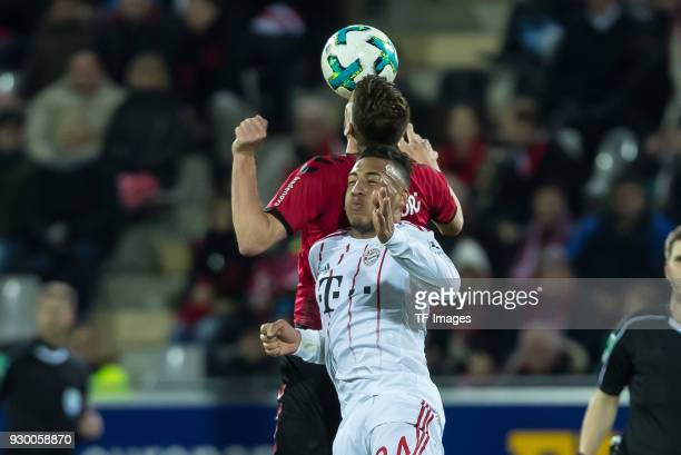 Janik Haberer of Freiburg and Corentin Tolisso of Muenchen battle for the ball during the Bundesliga match between SportClub Freiburg and FC Bayern...