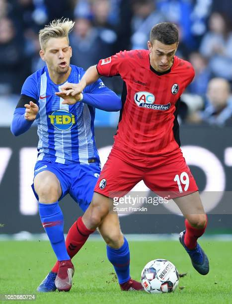 Janik Haberer of Freiburg holds off Arne Maier of Hertha BSC during the Bundesliga match between Hertha BSC and SportClub Freiburg at Olympiastadion...