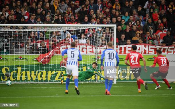 Janik Haberer of Freiburg scores his team's first goal by penalty past goalkeeper Rune Jarstein of Berlinduring the Bundesliga match between...