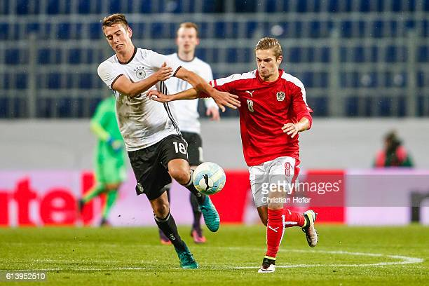Janik Haberer of Germany challenges Andreas Gruber of Austria for the ball during the 2017 UEFA European U21 Championships Qualifier between U21...