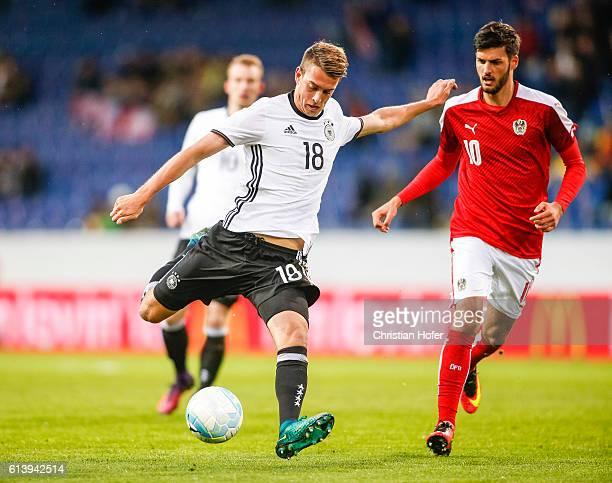 Janik Haberer of Germany challenges Florian Grillitsch of Austria during the 2017 UEFA European U21 Championships Qualifier between U21 Austria and...