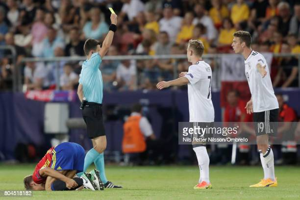 Janik Haberer of Germany is shown a yellow card by Referee Benoit Bastien during the UEFA European Under21 Championship Final between Germany and...