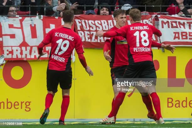 Janik Haberer of Sport-Club Freiburg, Nico Schlotterbeck of Sport-Club Freiburg and Nils Petersen of Sport-Club Freiburg celebrate after the team's...