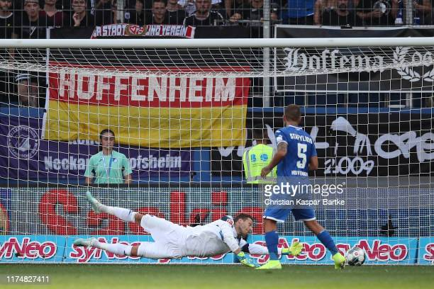 Janik Haberer of Sport-Club Freiburg scores his team second goal agains Oliver Baumann of Hoffenheim during the Bundesliga match between TSG 1899...