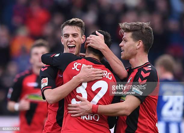 Janik Haberer Vincenzo Grifo and Florian Niederlechner of SC Freiburg celebrate the opening goal of Haberer during the Bundesliga match between Sport...