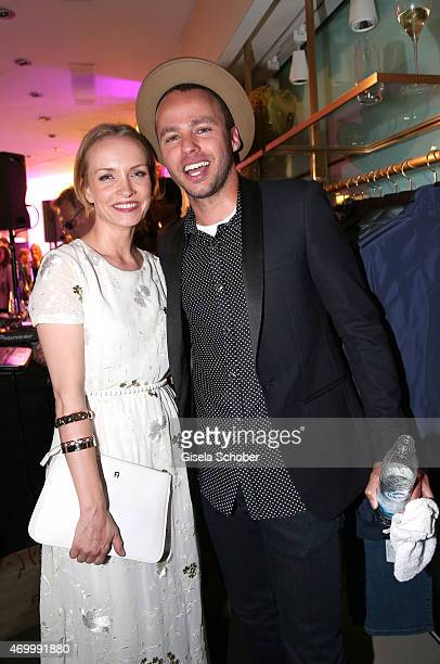 Janin Reinhardt and Marlon Roudette during the 50th Anniversary of AIGNER on April 16 2015 in Munich Germany