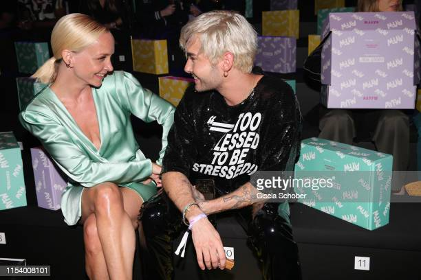 Janin Ullmann and Bill Kaulitz attend the opening show of the AYFW - About You Fashion Week at ewerk on July 05, 2019 in Berlin, Germany.