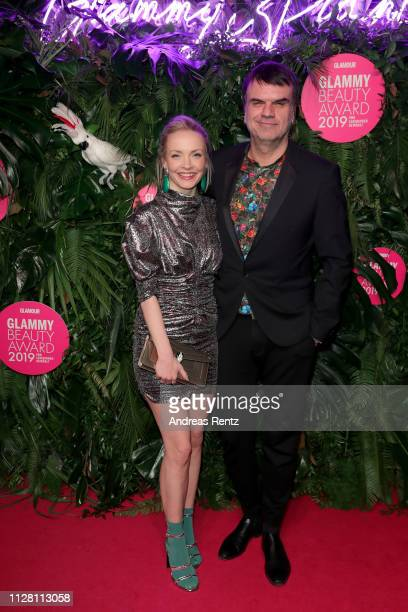 Janin Ullmann and Glamour Publisher Andre Pollmann arrive at the Glammy Award on February 07, 2019 in Munich, Germany.