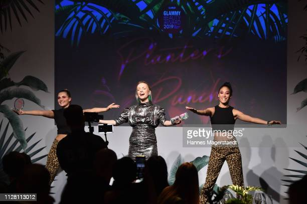 Janin Ullmann and performers on stage at the Glammy Award on February 07, 2019 in Munich, Germany.