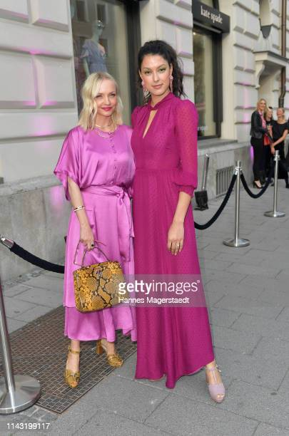 Janin Ullmann and Rebecca Mir during the opening of the new Kate Spade New York boutique store on April 16 2019 in Munich Germany This store marks...