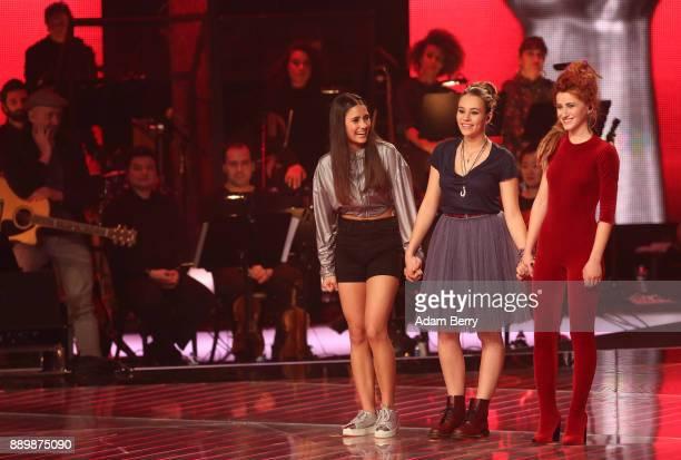 Janina Beyerlein Lara Samira Will and Natia Todua stand on stage during the 'The Voice of Germany' semifinals at Studio Berlin Adlershof on December...
