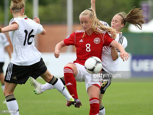 Janina Meissner of Germany and Theresa Panfil of Germany challenge Mille Poulsen of Denmark during the Women's U17 European Championship Semi Final...