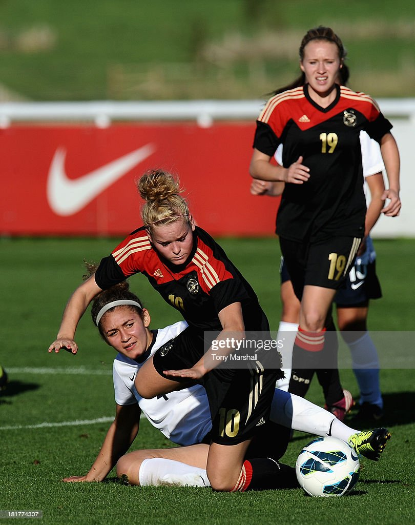 Janina Meissner of Germany tackled by Jade Bailey of England during the Women's International Friendly match between England Under 19 Women and Germany Under 19 Women at St George's Park on September 22, 2013 in Burton upon Trent, England.