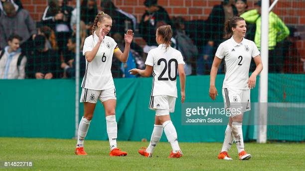 Janina Minge Kristin Koegel and Dina Orschmann of Germany celebrate after the international friendly match between U19 Women's Germany and U19...