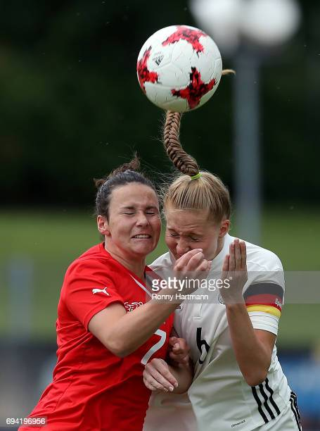Janina Minge of Germany and Thais Hurni of Switzerland head for the ball during the U19 women's elite round match between Germany and Switzerland at...