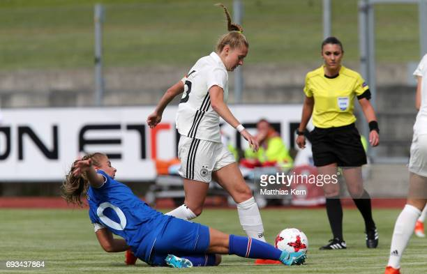 Janina Minge of Germany battles for the ball with Andrea Mist Palsdottir of Iceland during the U19 women's elite round match between Germany and...