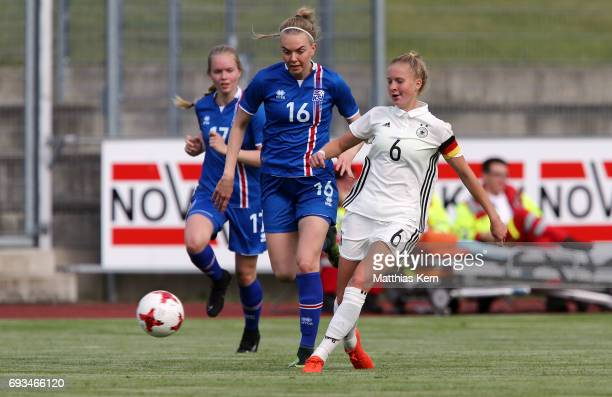 Janina Minge of Germany battles for the ball with Lara Mist Baldursdottir of Iceland during the U19 women's elite round match between Germany and...