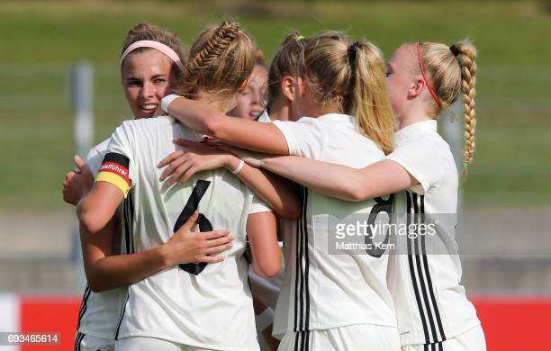 Janina Minge of Germany jubilates with team mates after scoring the second goal during the U19 women's elite round match between Germany and Iceland...