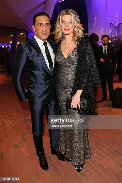 Janina Oezen-Otto , pregnant and her husband Ismail Oezen during the opening concert of the Elbphilharmonie concert hall on January 11, 2017 in...
