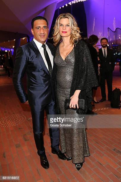 Janina OezenOtto pregnant and her husband Ismail Oezen during the opening concert of the Elbphilharmonie concert hall on January 11 2017 in Hamburg...