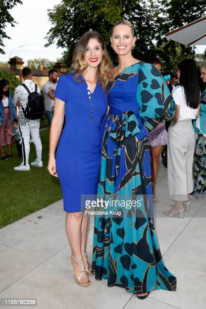 "Janina Otto and Karolina Kurkova during the CYBEX by Karolina Kurkova ""4th of July Fashion BBQ"" at Villa Westend on July 4, 2019 in Berlin, Germany."
