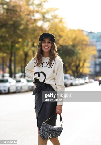 Janina Pfau wearing a Gucci sweater skirt from Petar Petrov Isabel Marant shoes and a Dior saddle bag on October 08 2018 in Hamburg