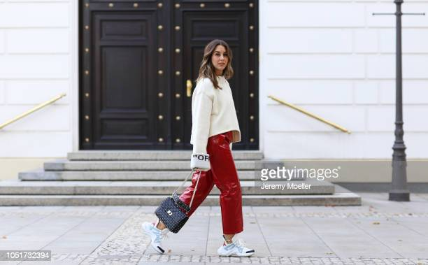 Janina Pfau wearing a Off White sweater Louis Vuitton Archlight Sneaker Valentino bag and pants from Petar Petrov on October 08 2018 in Hamburg