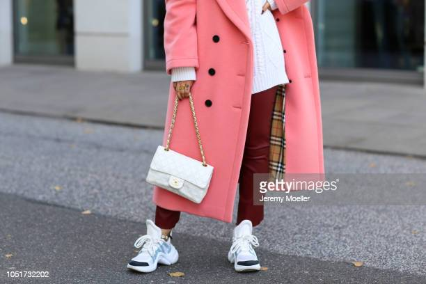Janina Pfau wearing a Valentino sweater Arma leather pants Louis Vuitton Archlight Sneaker Burberry coat and a Chanel bag on October 08 2018 in...