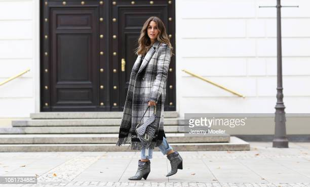 Janina Pfau wearing a Valentino sweater Off White coat Dior saddle bag and Isabel Marant boots on October 08 2018 in Hamburg