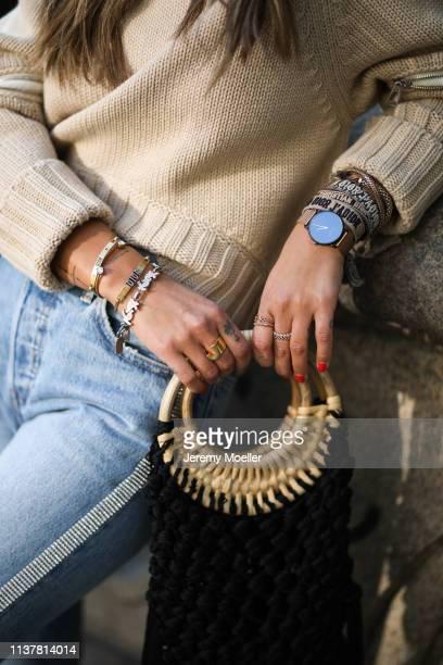 Janina Pfau wearing Levi's jeans Alexander McQueen sweater Zara fringes bag on March 22 2019 in Hamburg Germany