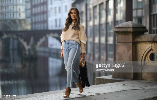 Janina Pfau wearing Levi's jeans Alexander McQueen sweater Zara fringes bag Roger vivier pumps on March 22 2019 in Hamburg Germany