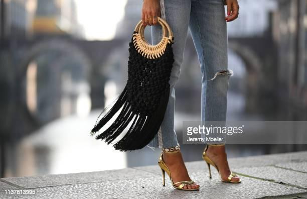 Janina Pfau wearing Levi's jeans Zara fringes bag Roger vivier pumps on March 22 2019 in Hamburg Germany