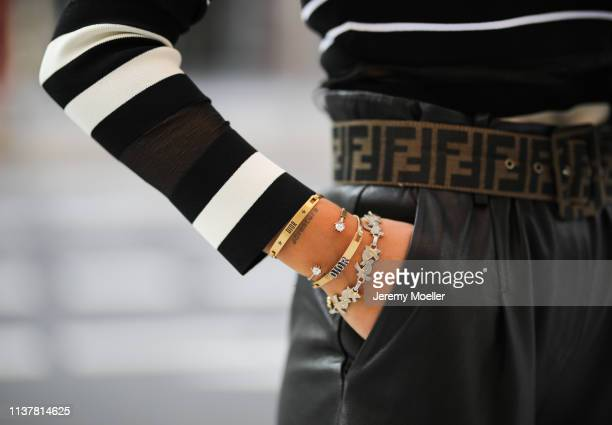 Janina Pfau wearing Off white shirt Fendi belt black Arma pants Dior jewelry Chanel backpack on March 22 2019 in Hamburg Germany