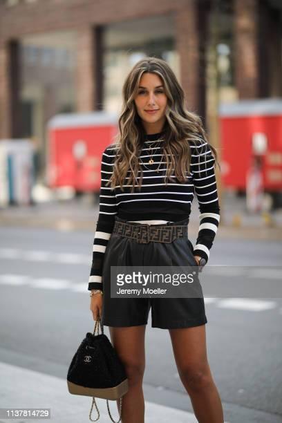 Janina Pfau wearing Off white shirt Fendi belt black Arma pants Dior jewelry Chanel backpack on March 22 2019 in Hamburg Germany
