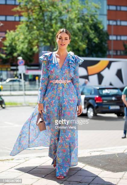 Janina Uhse is seen wearing dress with floral print outside Marina Hoermanseder during Berlin Fashion Week on July 04 2019 in Berlin Germany