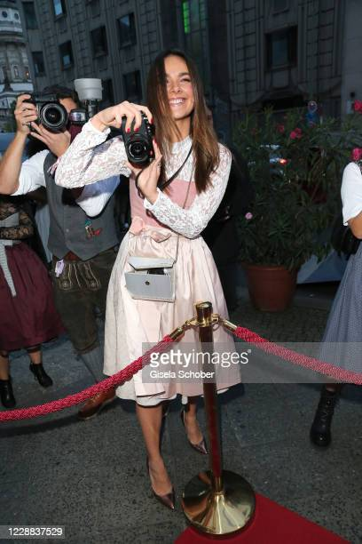 Janina Uhse photographs during the Madlwiesn 2020 at Restaurant Borchardt on October 1 2020 in Berlin Germany