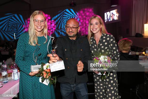 "Janina Vilsmaier, Director Arash T. Riahi with award for his movie ""Ein bisschen bleiben wir noch"" and Josefina Vilsmaier during the festival night..."