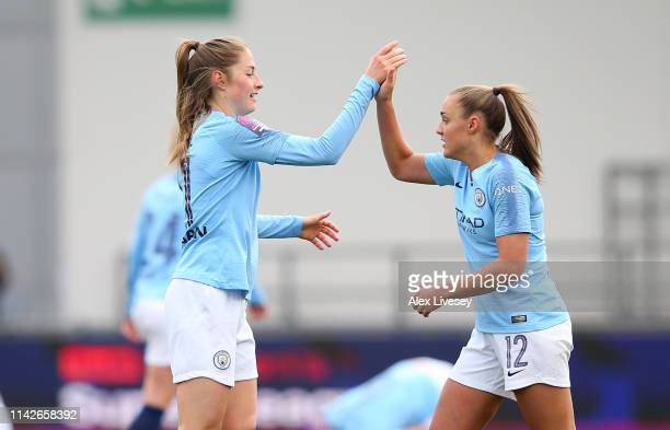 Janine Beckie and Georgia Stanway of Manchester City Women celebrate victory after the Women's FA Cup Semi Final match between Manchester City Women...