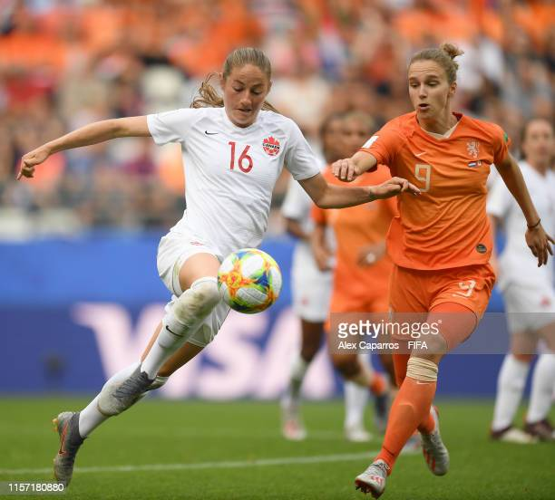 Janine Beckie of Canada battles for possession with Vivianne Miedema of the Netherlands during the 2019 FIFA Women's World Cup France group E match...