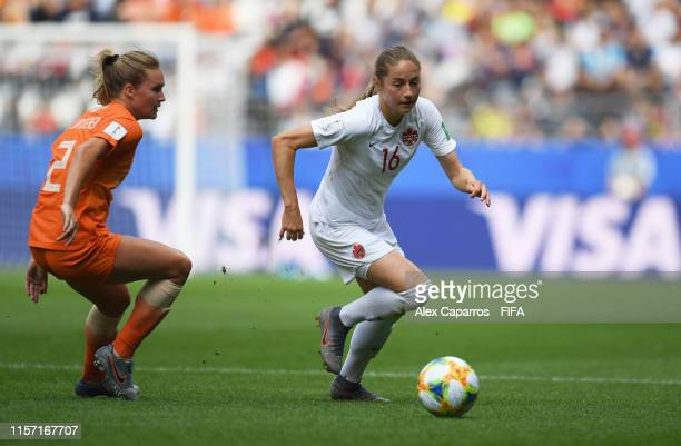 Janine Beckie of Canada runs with the ball under pressure from Desiree Van Lunteren of the Netherlands during the 2019 FIFA Women's World Cup France...