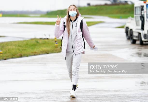 Janine Beckie of Manchester City boards the team flight at Manchester Airport for the trip to Gothenburg on December 08, 2020 in Manchester, England.