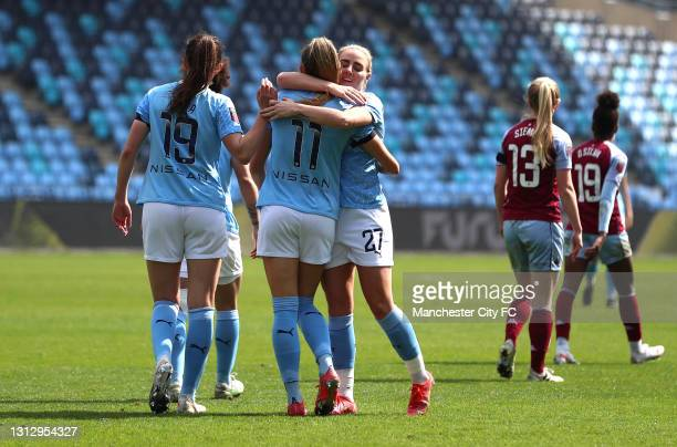 Janine Beckie of Manchester City celebrates scoring her sides third goal with team mates during the Vitality Women's FA Cup Fourth Round match...
