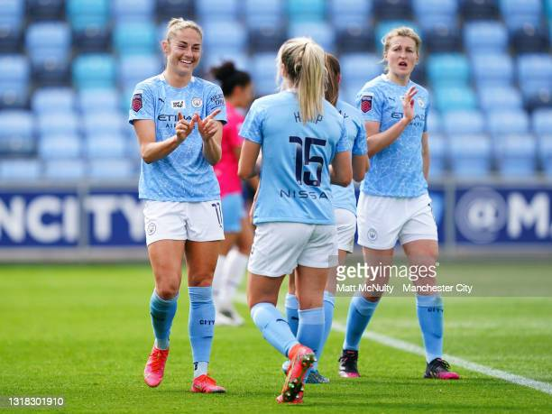 Janine Beckie of Manchester City celebrates with teammates after scoring her teams second goal during the FA Cup 5th Round match between Manchester...