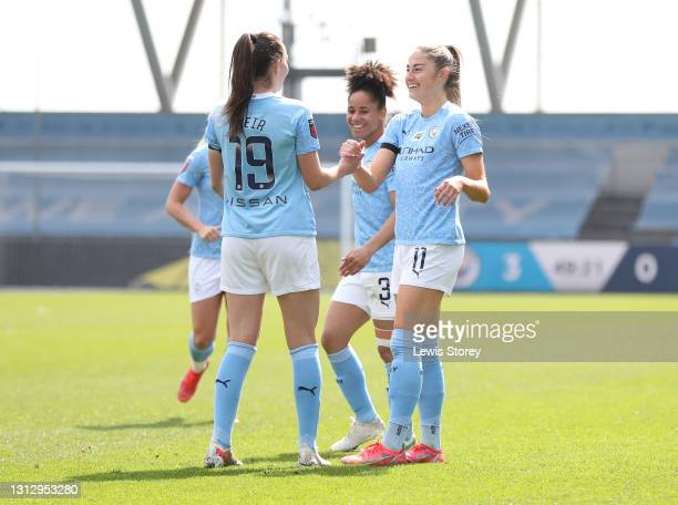 Janine Beckie of Manchester City celebrates with teammates Demi Stokes and Caroline Weir after scoring their team's fourth goal during the Vitality...