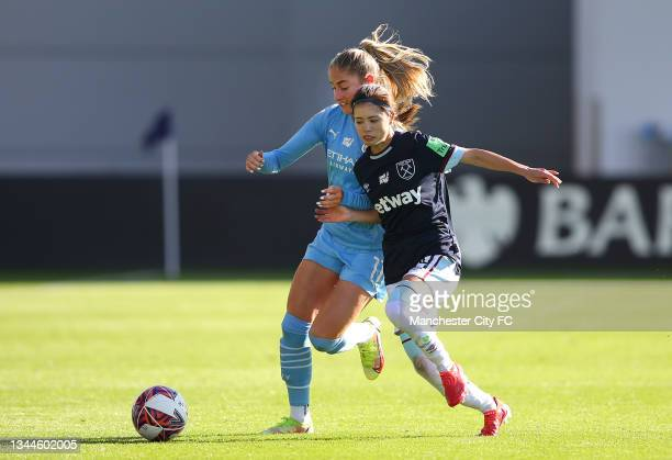 Janine Beckie of Manchester City Women is tackled by Yui Hasegawa of West Ham United Women during the Barclays FA Women's Super League match between...