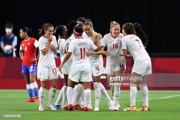 Janine Beckie of Team Canada celebrates with teammates after scoring their side's second goal during the Women's First Round Group E match between...
