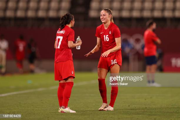 Janine Beckie of Team Canada interacts with Jessie Fleming of Team Canada as they celebrate victory in the Women's Semi-Final match between USA and...